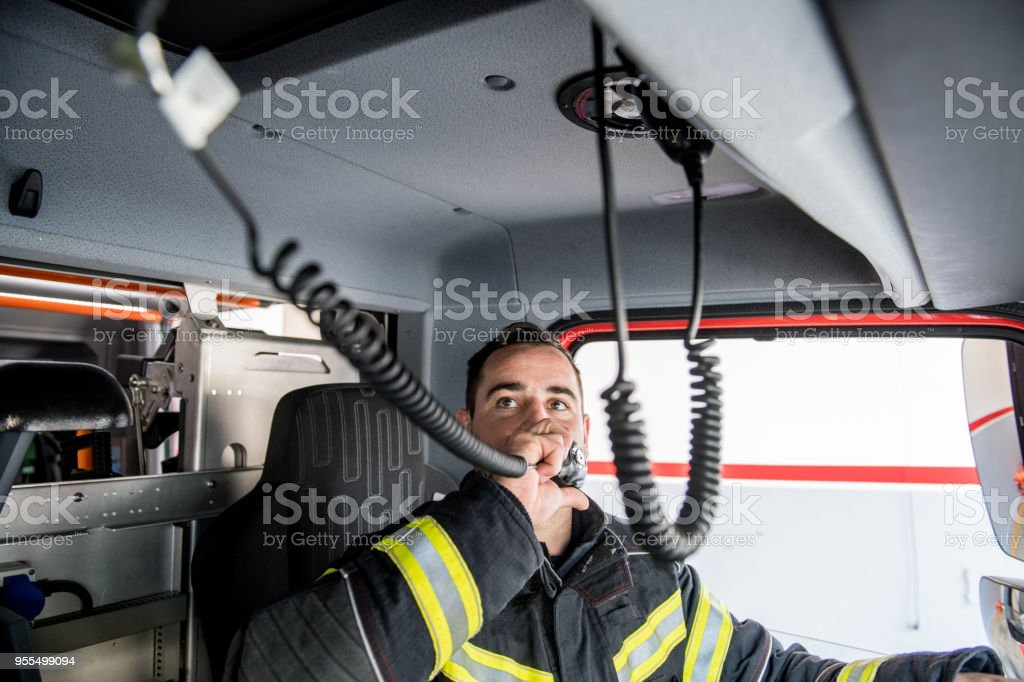Firefighter driving - emergency call stock photo