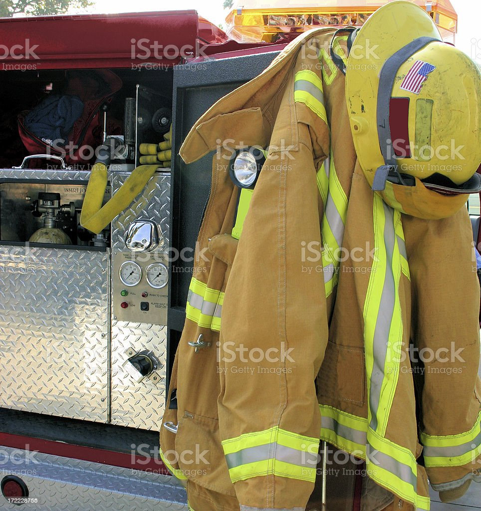 firefighter equipment on back of rig stock photo