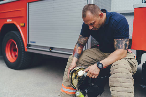 firefighter feeling depressed after rescue operation - man face down stock pictures, royalty-free photos & images