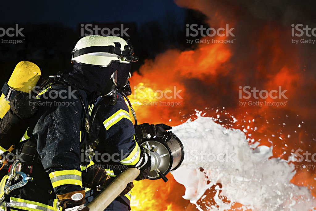 Firefighter - Firemen extinguishing a large blaze stock photo