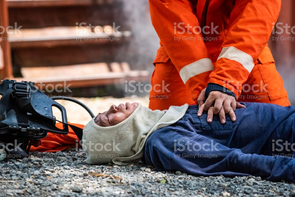 Medium shot of firefighter in fire suit on safety rescue duty help...