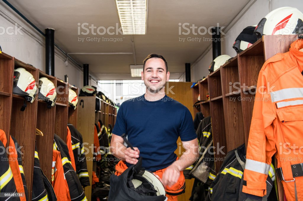 Firefighter in a locker room royalty-free stock photo