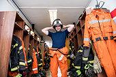 Firefighter in the locker room; all logos removed. Slovenia, Europe. Nikon.