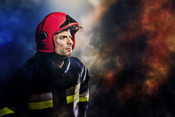 Firefighter in a smoke Firefighter in action smoke jumper stock pictures, royalty-free photos & images