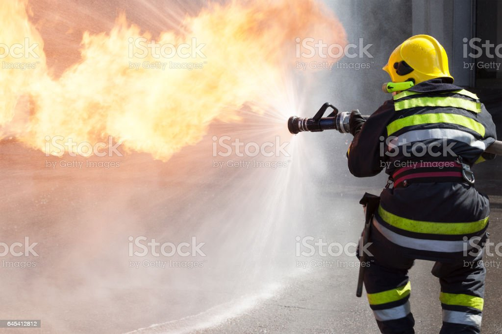 Firefighter in action stock photo