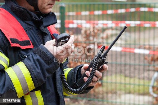 istock Firefighter in action with walkie takie in the hand 577637848
