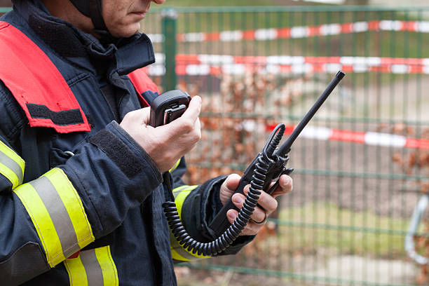 Firefighter in action with walkie takie in the hand Firefighter in action with walkie takie in the hand smoke jumper stock pictures, royalty-free photos & images