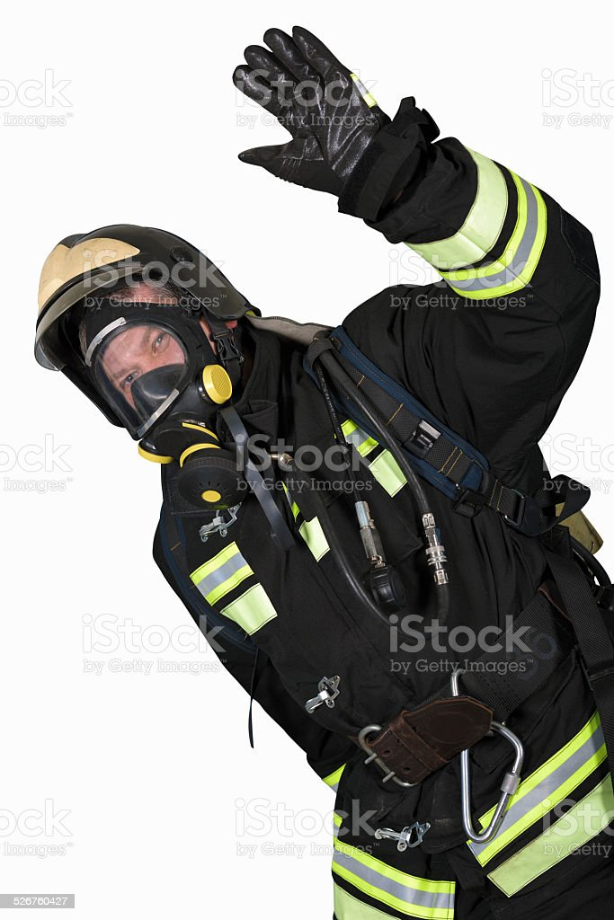 Firefighter in breathing apparatus gestures Ok stock photo