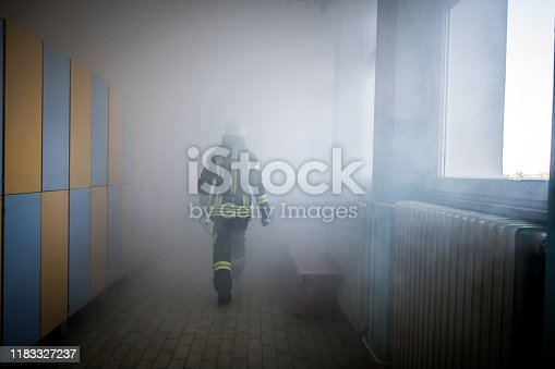Firefighter in a fire and rescue operation.