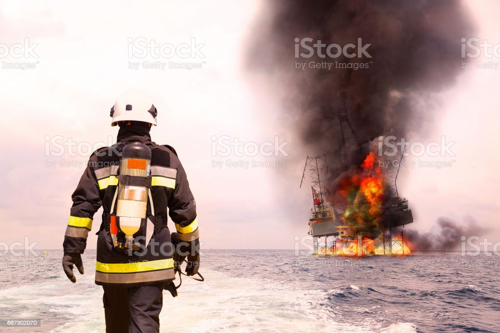 Firefighter in oil and gas industry with mission successful for protect with emergency case or worst case, Personal protective equipment of firefighter team and teamwork for danger mission. stock photo