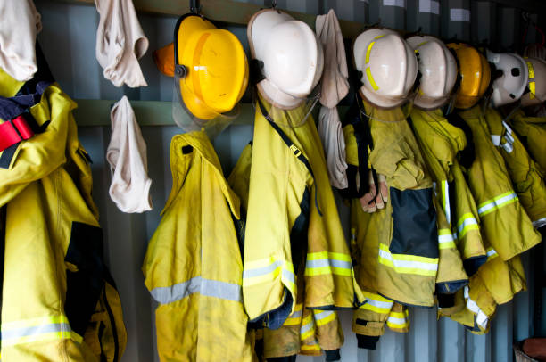 Firefighter Jackets and Helmets stock photo