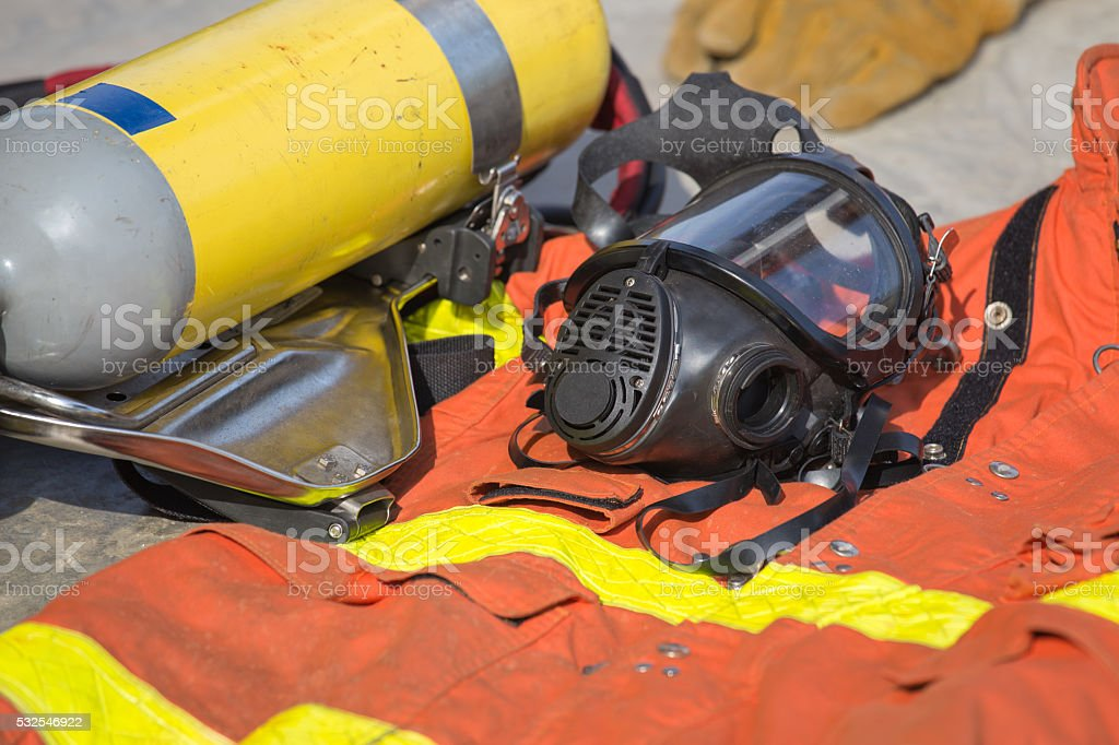 firefighter mask and equipment prepare for operation stock photo