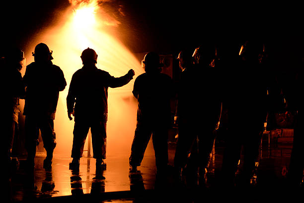 firefighter night industry. - emergency response stock pictures, royalty-free photos & images