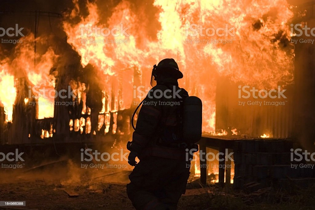 A firefighter on duty scene to fire-off the fire stock photo