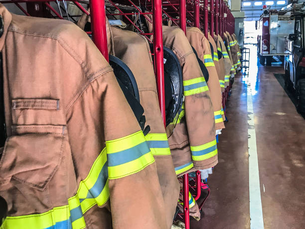 Firefighter Personal Protective Equipment PPE Firefighter PPE extinguishing stock pictures, royalty-free photos & images