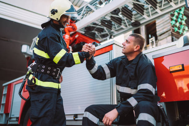 Firefighter Firefighter after rescue operation ambulance staff stock pictures, royalty-free photos & images