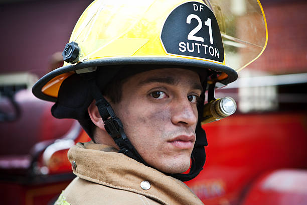 firefighter - helmet visor stock photos and pictures
