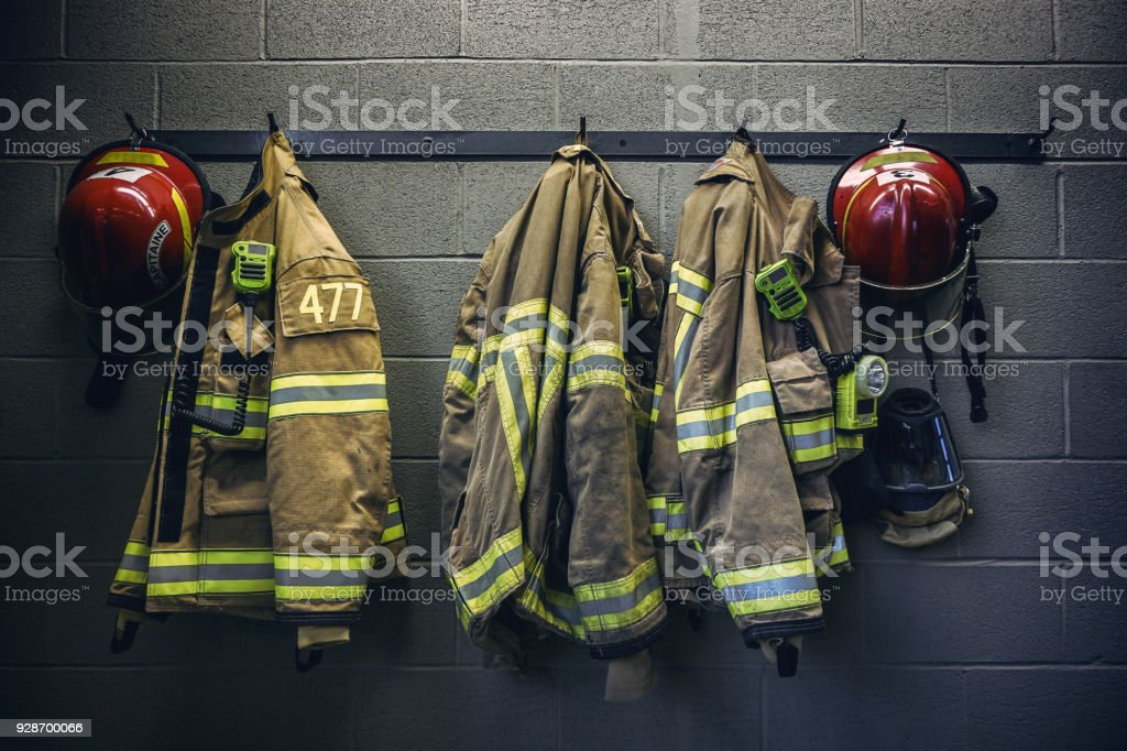 Firefighter firefighter protection clothe and respiratory mask Accidents and Disasters Stock Photo