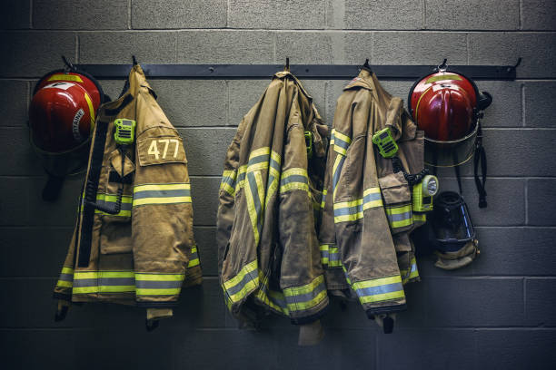 Firefighter firefighter protection clothe and respiratory mask equipment stock pictures, royalty-free photos & images