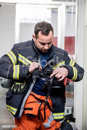 Firefighter with a gas mask; all logos removed. Slovenia, Europe. Nikon.
