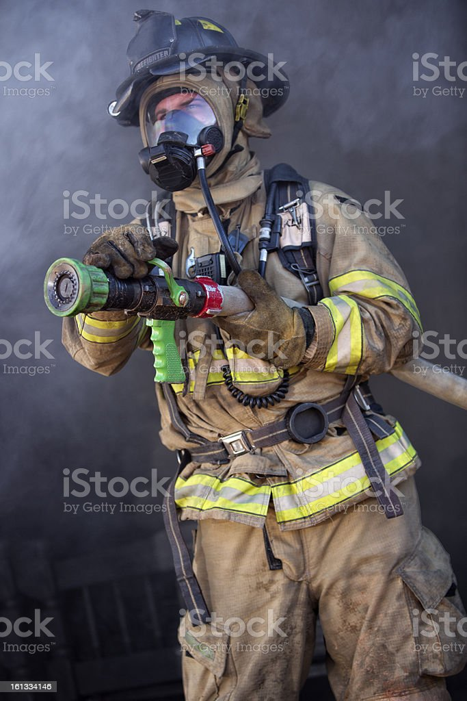Firefighter ready to spray water stock photo