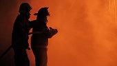istock Firefighter spray water fighting 1301325560