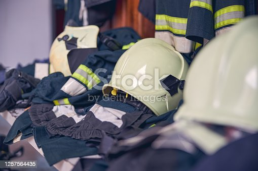 Close up portrait of protective work uniform lying in the bench