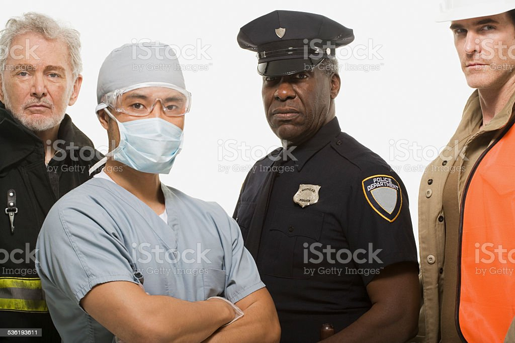 Firefighter surgeon police officer and construction worker stock photo