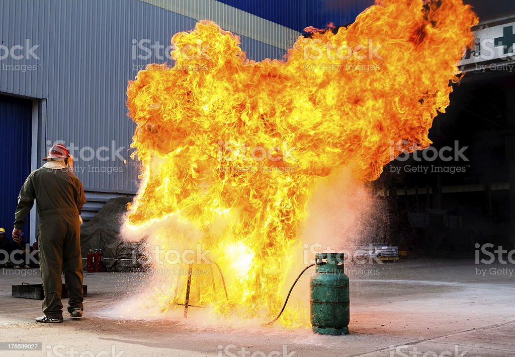 Fire-fighter trains extinguishing a fire stock photo