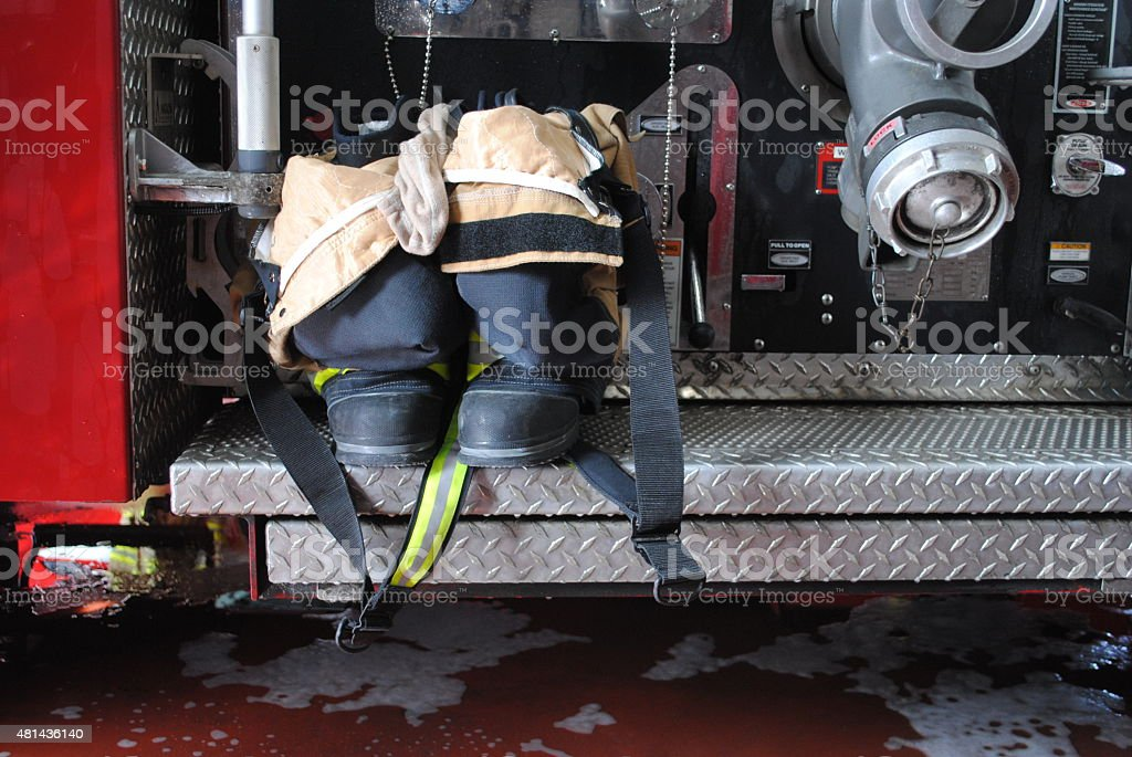Firefighter Uniform and Boots on Firetruck stock photo