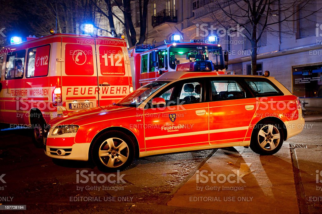 Firefighter vehicles at the place of a house fire, Wiesbaden royalty-free stock photo