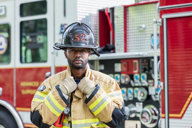 Firefighter wearing protective gear stock photo
