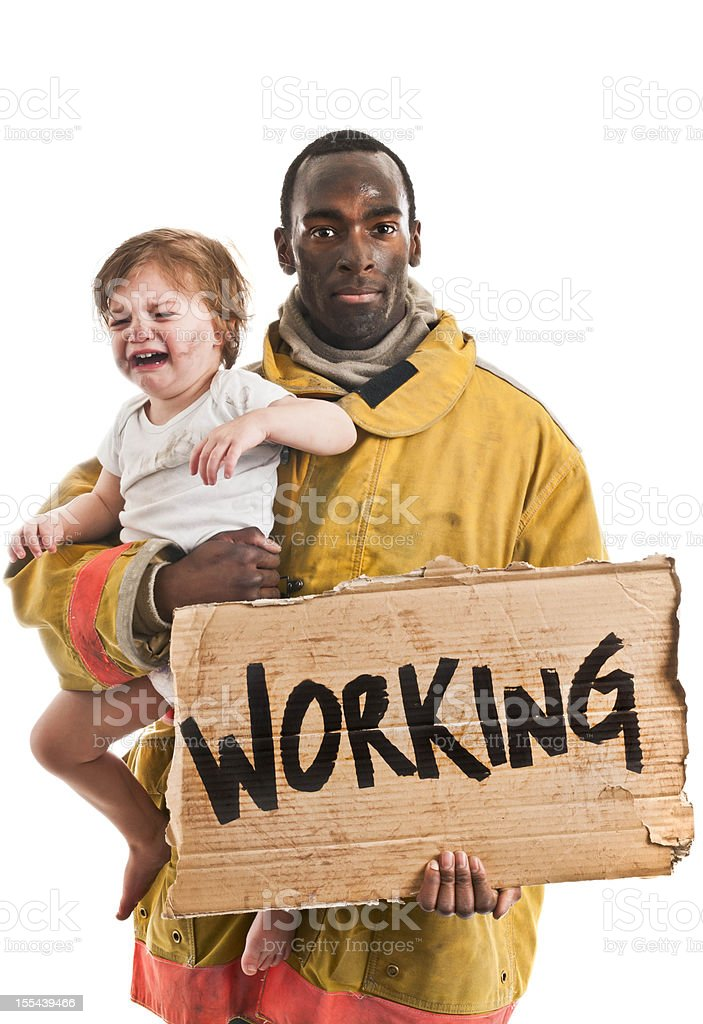 Firefighter With Rescued Toddler stock photo