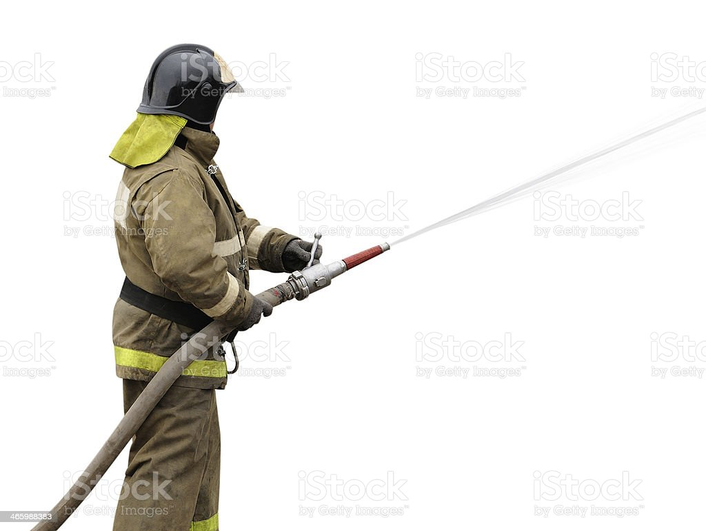 Firefighter working with fog nozzle stock photo
