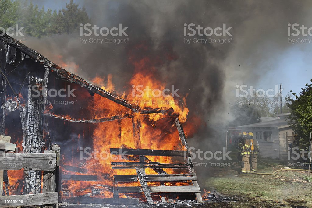 firefighters and burning barn stock photo