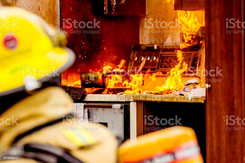 Pompiers et feu de cuisine - Photo