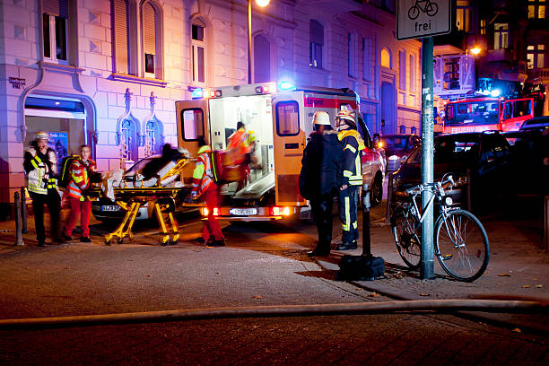 Firefighters and paramedics at place of action stock photo