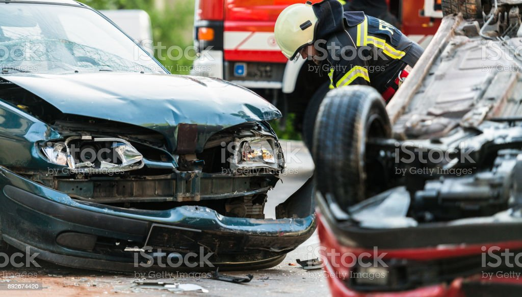 Firefighters At A Car Accident Scene stock photo