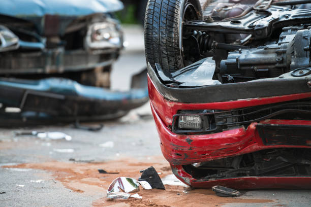 firefighters at a car accident scene - car accident stock photos and pictures