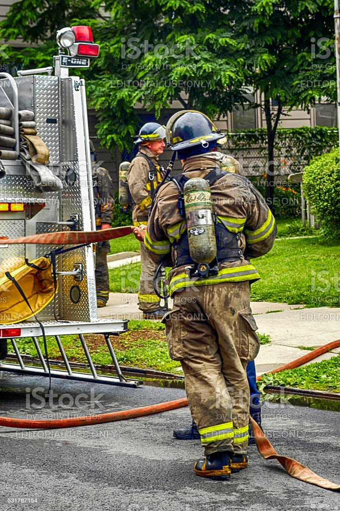 Firefighters at a house fire in Toledo, Ohio stock photo