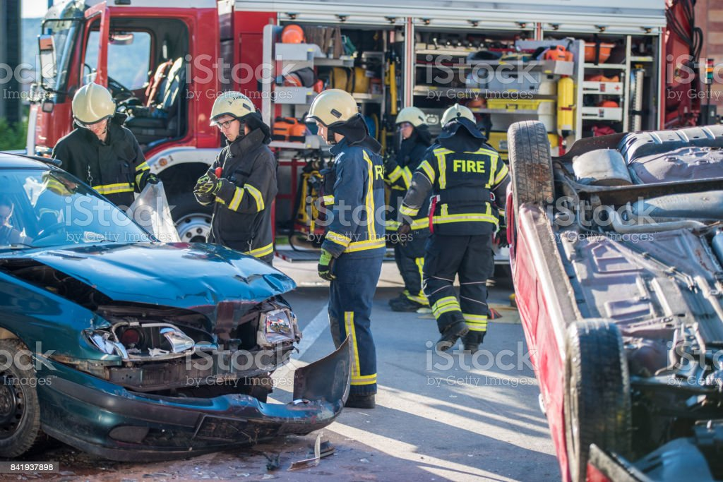 Firefighters at accident'n stock photo
