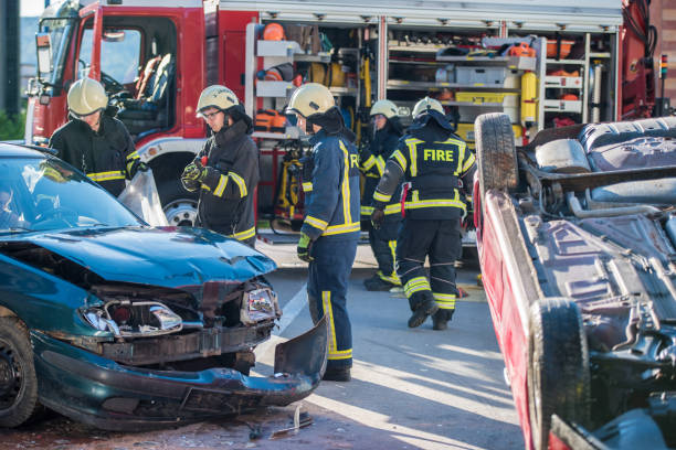 "firefighters at accident""n - car accident stock photos and pictures"