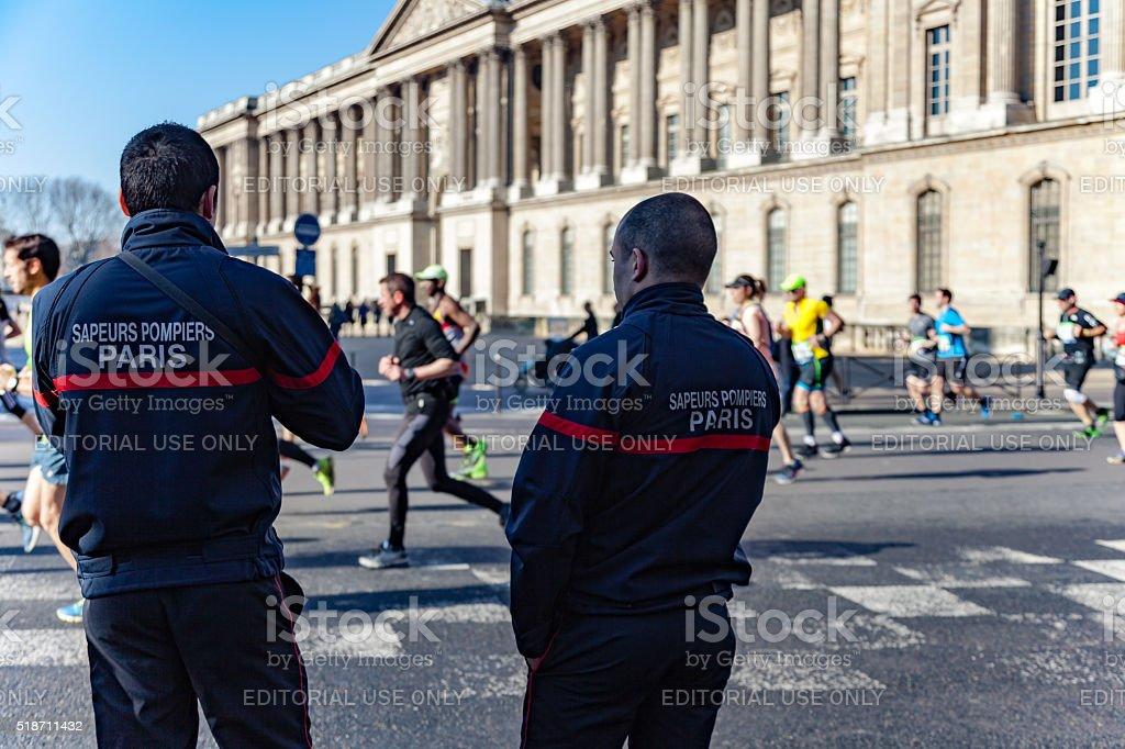 Firefighters at Marathon of Paris stock photo