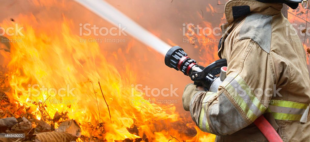 firefighters battle a wildfire stock photo