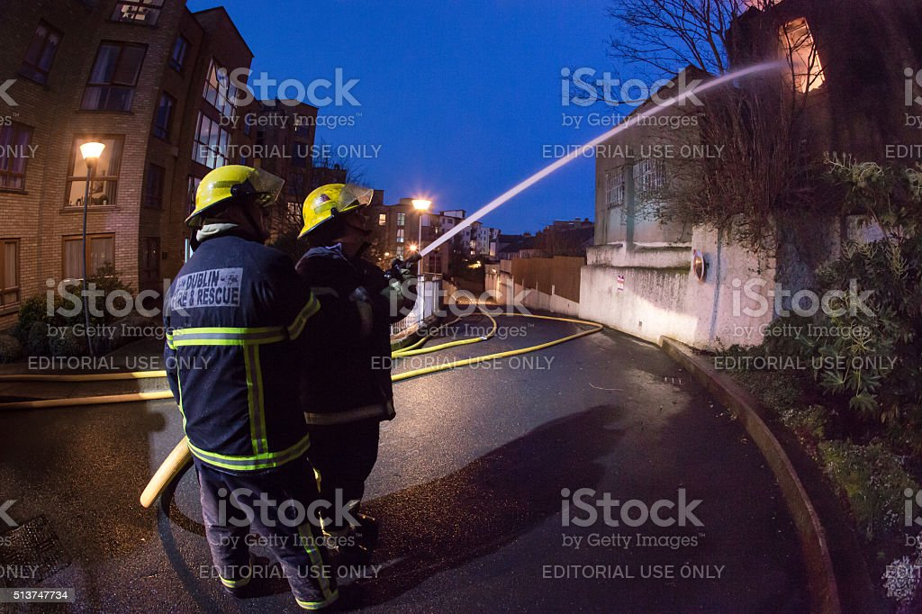 Firefighters cooperation stock photo