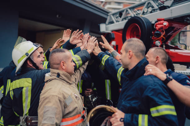Firefighters doing high five stock photo