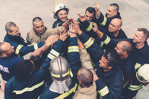 Firefighters Doing High Five Stock Photo - Download Image Now