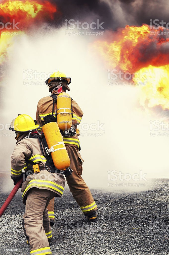 Firefighters Douse Inferno stock photo