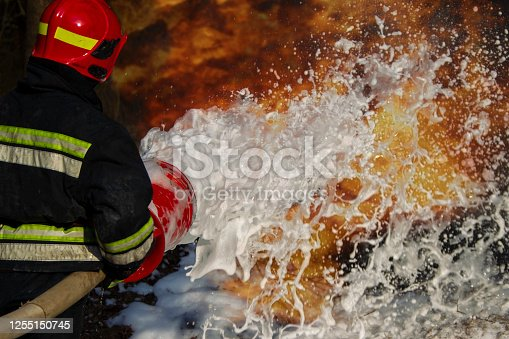 Firefighters extinguish a fire. Fire foam and fire.