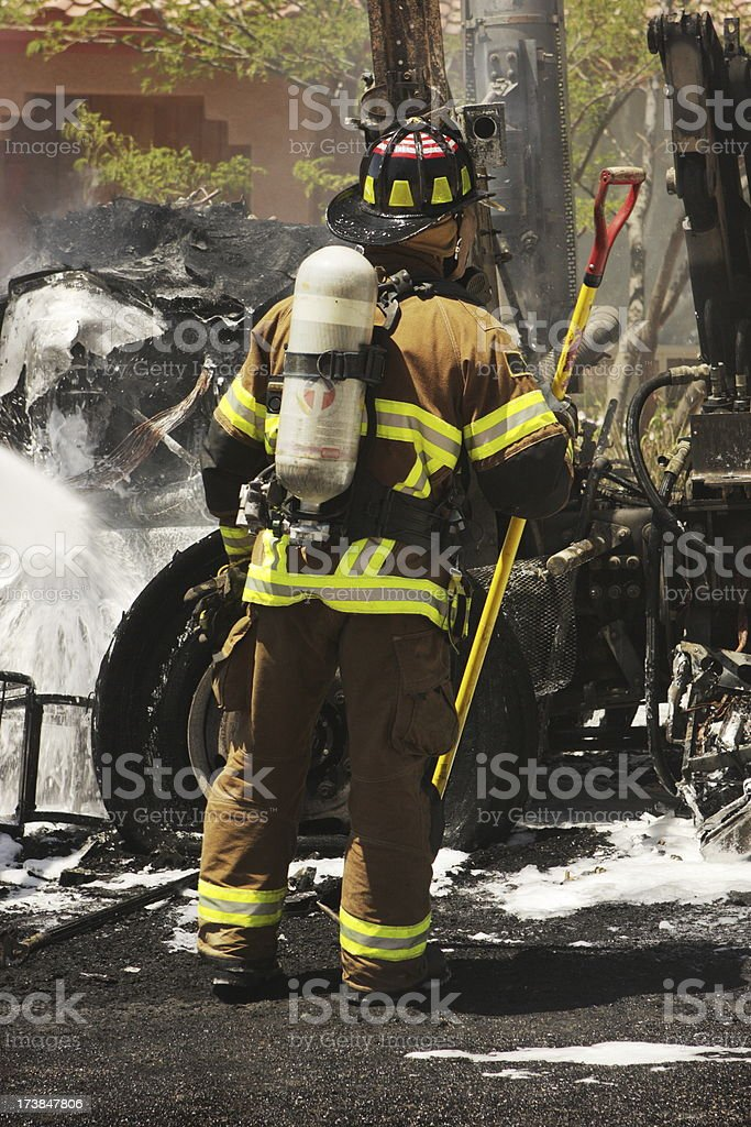 Firefighters Extinguish Fire Burnt Truck stock photo